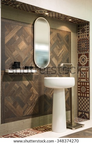 Washbasin and mirror in bathroom - stock photo