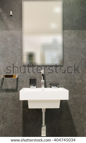 Washbasin and mirror in bathroom interior - stock photo