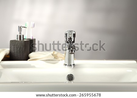 washbasin and white towel soap and wall  - stock photo