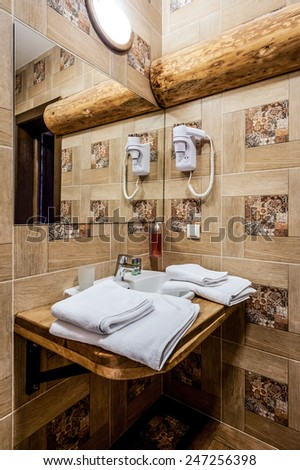 Washbasin in the bathroom. Modern style. Hairdryer, white towels, liquid soap, mirror. - stock photo