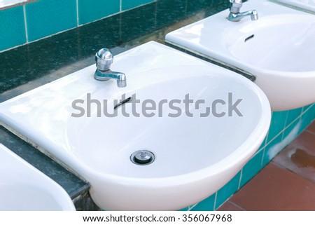 Washbasin sink public outdoor.  - stock photo