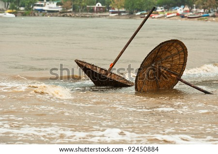 Washed away umbrellas in the great storm - stock photo