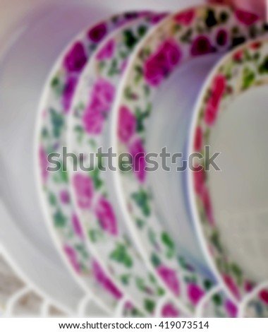 Washed plates stacked vertically,Very soft focus, blurred for background - stock photo