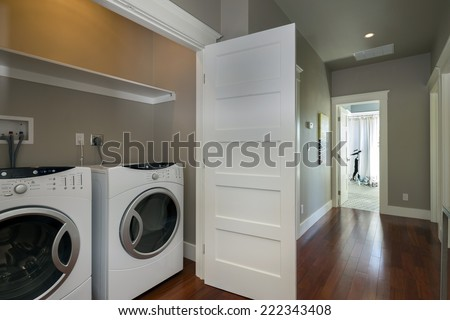 Washer and dryer in luxury home.  - stock photo