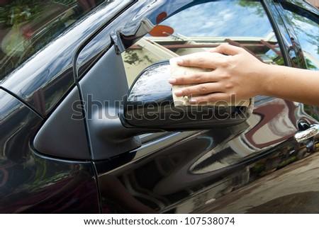 Washing a black car - stock photo