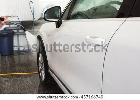 washing car closeup - stock photo
