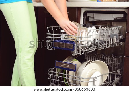 Washing dishes in the kitchen