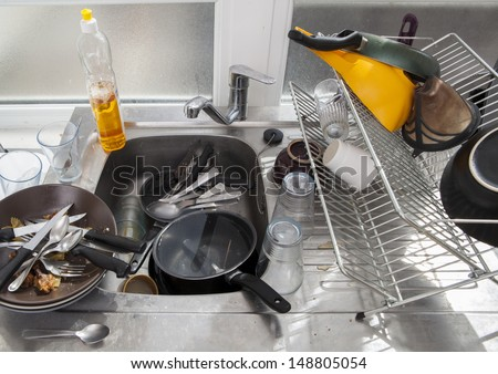 Washing dishes on a kitchen  - stock photo