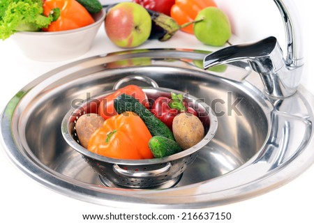 Washing fruits and vegetables close-up - stock photo
