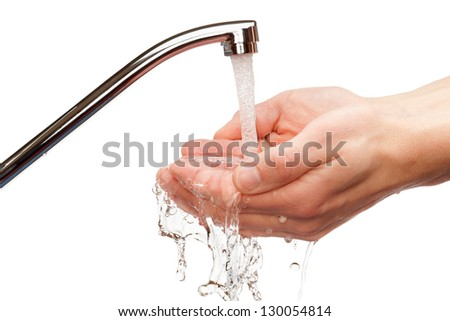 Washing hands under flowing tap water, isolated on the white background. - stock photo