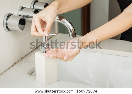 Washing hands with soap - stock photo