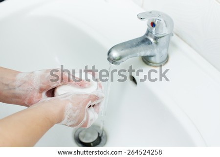 Washing Hands with soap in bathroom. Hygiene  - stock photo