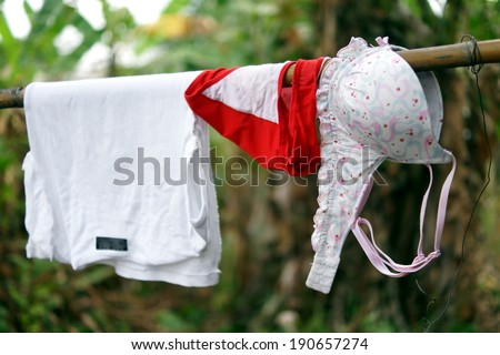 Washing hung out to dry in the jungle - stock photo