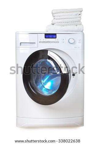 Washing machine and towels - stock photo