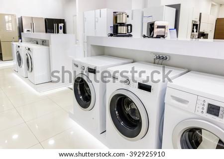 washing mashines in appliance store - stock photo