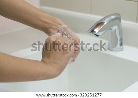 Washing of hands with soap.