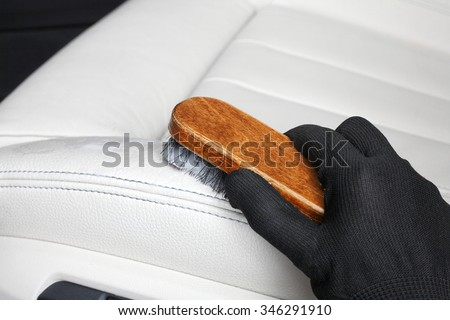 Washing of interior by a soft brush with foam. - stock photo