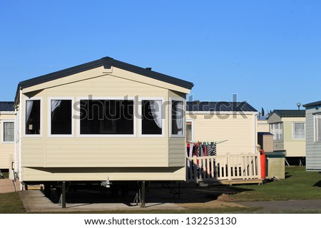 Washing outside trailer in caravan park, Scarborough, England. - stock photo