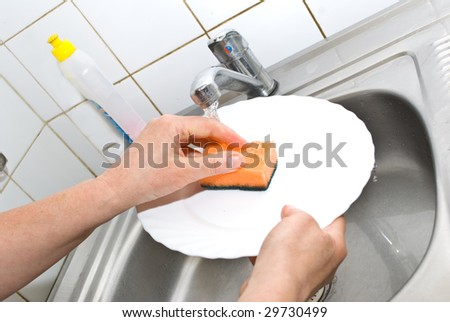 Washing plate  in the kitchen