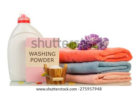 Washing powder and towels, isolated on white - stock photo