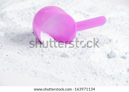 washing powder with a measuring spoon  - stock photo