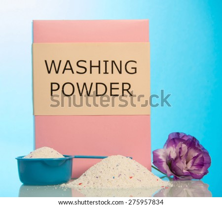 Washing powder with scoop and flowers - stock photo