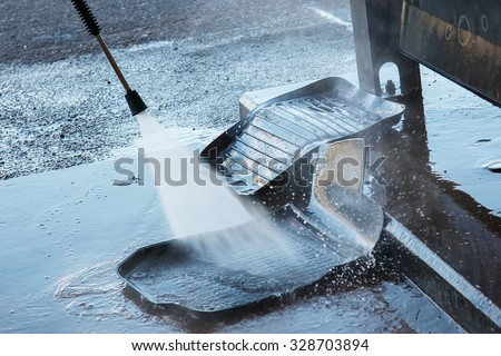 Washing rubber carpets in a car wash - stock photo