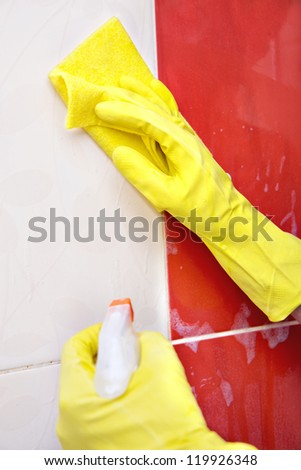 washing the tiles in the bathroom, cleaning kit apartment, hygienic cleaning,  gloves, sponge and cloth - stock photo