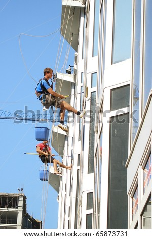 washing window cleaning men Industrial mountaineering building city