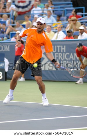 WASHINGTON - AUGUST 4: Alejandro Falla (COL) plays Lleyton Hewitt (AUS)  at the Legg Mason Tennis Classic on August 4, 2010 in Washington. Hewitt retired the match due to a right calf injury. - stock photo
