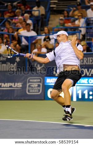 WASHINGTON - AUGUST 5: Andy Roddick (USA) during his stunning early elimination by Gilles Simon (FRA, not pictured) from the Legg Mason Tennis Classic on August 5, 2010 in Washington. - stock photo