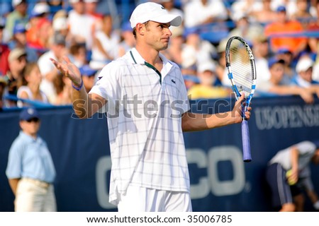 WASHINGTON - AUGUST 9: Andy Roddick (USA) gestures in the championship match of the Legg Mason Tennis Classic on August 9, 2009 in Washington. Roddick was defeated by Juan Martin Del Potro (ARG). - stock photo