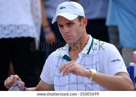 WASHINGTON - AUGUST 9: Andy Roddick (USA) takes a break at the Legg Mason Tennis Classic on August 9, 2009 in Washington. Roddick was defeated by Juan Martin Del Potro (ARG). - stock photo