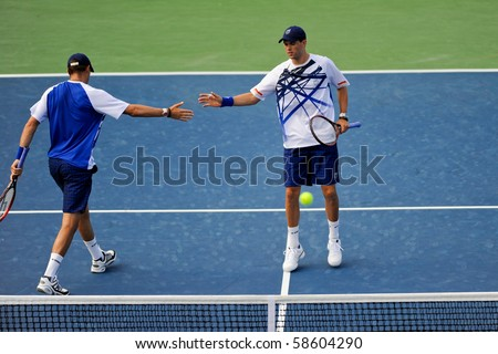 WASHINGTON - AUGUST 6:  Bob and Mike Bryan (USA) fall to Rohan Bopanna (IND) and Aisam-Ul-Haq Qureshi (PAK) at the Legg Mason Tennis Classic on August 6, 2010 in Washington. - stock photo