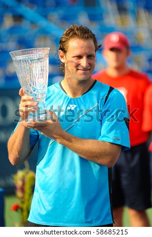 WASHINGTON - AUGUST 8: David Nalbandian (ARG) holds his trophy after beating Marcos Baghdatis (CYP, not pictured) to capture the title of the Legg Mason Tennis Classic on August 8, 2010 in Washington. - stock photo