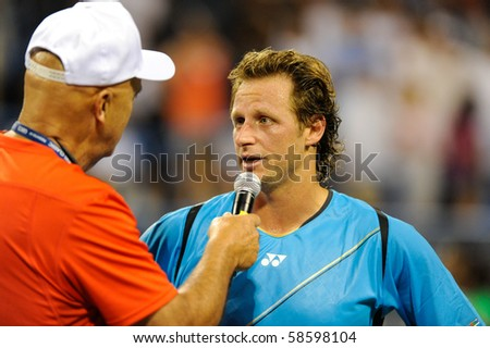 WASHINGTON - AUGUST 6: David Nalbandian (ARG) is interviewed after defeating Gilles Simon (FRA, not pictured) in quarterfinal action at the Legg Mason Tennis Classic on August 6, 2010 in Washington. - stock photo