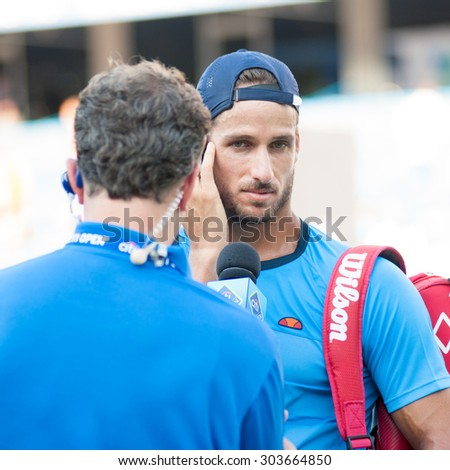 WASHINGTON - AUGUST 5: Feliciano Lopez (ESP) is interviewed after defeating Lleyton Hewitt (AUS, not pictured) at the Citi Open tennis tournament on August 5, 2015 in Washington DC   - stock photo