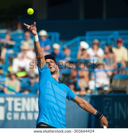 WASHINGTON - AUGUST 5: Feliciano Lopez (ESP) serves during his winning match against Lleyton Hewitt (AUS, not pictured) at the Citi Open tennis tournament on August 5, 2015 in Washington DC   - stock photo