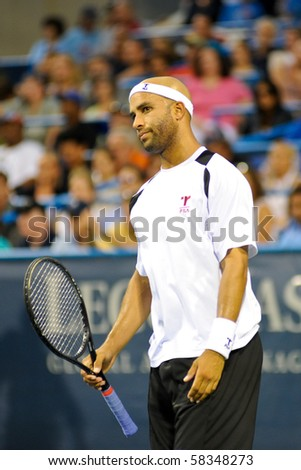 WASHINGTON - AUGUST 2: James Blake (USA) questions a call in his match against Ryan Sweeting (USA) at the Legg Mason Tennis Classic on August 2, 2010 in Washington.  Sweeting defeated Blake. - stock photo