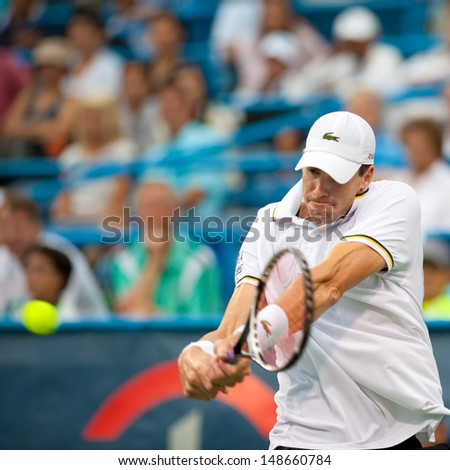 WASHINGTON - AUGUST 3, 2013:  John Isner (USA) defeats Dmitry Tursunov (RUS, not pictured) in the semifinals of the Citi Open tennis tournament on August 3, 2013 in Washington - stock photo