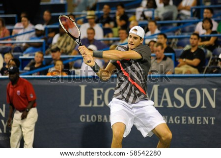 WASHINGTON - AUGUST 5: John Isner (USA) is defeated by Xavier Malisse (BEL, not pictured) at the Legg Mason Tennis Classic on August 5, 2010 in Washington. - stock photo