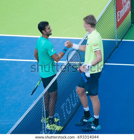 WASHINGTON – AUGUST 4: Kevin Anderson (RSA) and Yuki Bhambri (IND) shake hands after Anderson's win at the Citi Open tennis tournament on August 4, 2017 in Washington DC