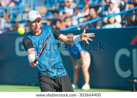 WASHINGTON - AUGUST 5: Lleyton Hewitt (AUS) falls to Feliciano Lopez (ESP, not pictured) at the Citi Open tennis tournament on August 5, 2015 in Washington DC - stock photo