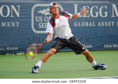 WASHINGTON - AUGUST 4: Lleyton Hewitt (AUS) plays against Alejandro Falla (COL) at the Legg Mason Tennis Classic on August 4, 2010 in Washington. Hewitt retired the match due to a calf injury. - stock photo