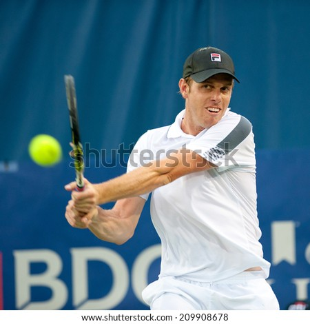 WASHINGTON - AUGUST 1: Sam Querrey (USA) during his winning doubles match with Steve Johnson (USA) at the Citi Open tennis tournament on August 1, 2014 in Washington DC - stock photo