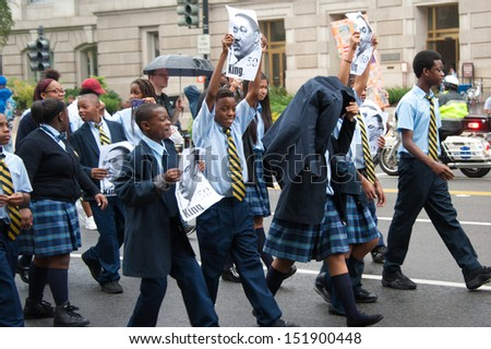WASHINGTON - AUGUST 28: Schoolchildren participate in the 50th anniversary of the March on Washington August 28, 2013 in Washington DC. - stock photo