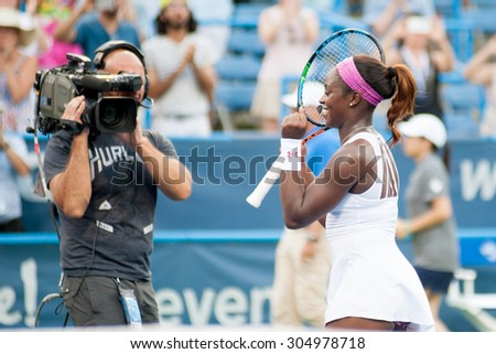 WASHINGTON AUGUST 9: Sloane Stephens (USA) celebrates after taking the women's title at the womens title of the Citi Open tennis tournament on August 9, 2015 in Washington DC - stock photo