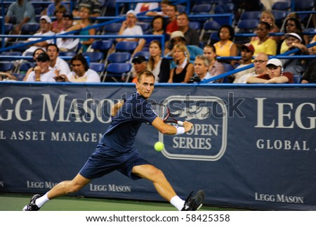 WASHINGTON - AUGUST 3: Thiemo de Bakker (NED) in action against John Isner (USA, not pictured) at the Legg Mason Tennis Classic on August 3, 2010 in Washington.   Isner defeated de Bakker. - stock photo