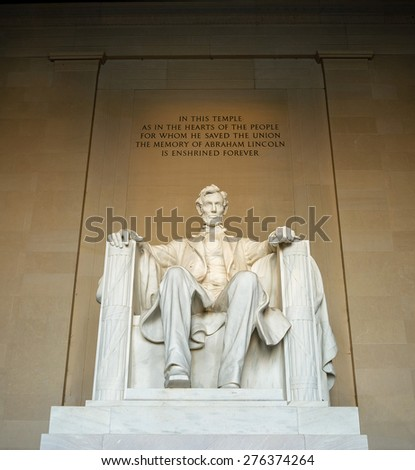 WASHINGTON D.C. - APRIL 13, 2013 - Statue of Abraham Lincoln sitting in a chair inside of the Lincoln Memorial.