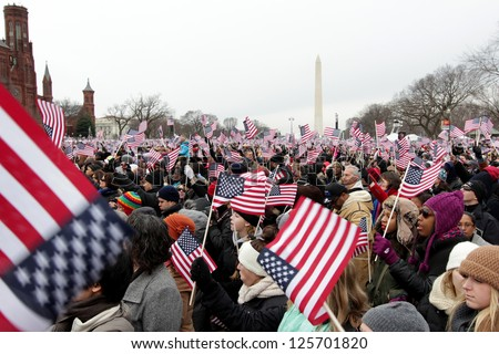WASHINGTON, D.C. - JANUARY 21: Crowd waving flags at 2013 Inauguration of Barack Obama on January 21, 2013 in Washington, D.C. - stock photo